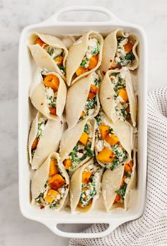 "Healthy Meals - Vegan Butternut Squash Stuffed Shells make a delicious fall dinner! Packed with spinach, squash, and creamy lemon ""ricotta,"" they're healthy and hearty! Vegan Foods, Vegan Dishes, Vegan Vegetarian, Vegetarian Recipes, Healthy Recipes, Paleo, Healthy Meals, Thanksgiving Vegetarian Dishes, Simple Vegan Meals"