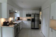 Kitchen remodel design wood cabinets granite backsplash custom home builder house renovations contractor construction interior tiles countertop stainless steel appliances floor