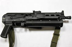"The PP-19 Bizon (""Bison"") is a 9mm submachine gun developed in the early 1990s at Izhmash by a team of engineers headed by Victor Kalashnikov (son of famed AK-47 designer Mikhail Kalashnikov). Alexi Dragunov, youngest son of Evgeny Dragunov (responsible for the SVD sniper rifle), was also a member of the design team."