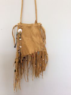 Beaded deerskin leather pouch, hand crafted with detailed stitching. Fringed and beaded...