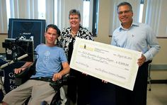 The Evergreen Chapter receives a check from retired New Orleans Saint Steve Gleason from proceeds from the Steve Gleason Classic. Image courtesy of the Evergreen Chapter