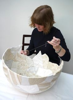 Zoë Hillyard, reassembling a broken ceramic bowl using fabric and thread