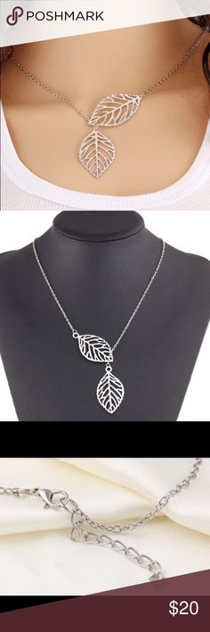 """Adjustable double leaf necklace silver necklace Sophisticated and feminine adjustable double leaf silver colored necklace. Dimensions 11"""" length with 2"""" adjustable clasp and chain in back. Jewelry Necklaces"""