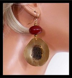Stunning earrings....handcut from bronze sheet, hammered and slightly dished. Antiqued. Hang from handmade amber resin beads. Very wearable....will work with just about any outfit!  Earrings are light in weight and measure about 3 inches in length, inc handforged 14KT GF french wires.