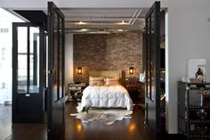 Amazing Loft. Bedroom enclosed in glass doors is super funky and a good way to create distinct rooms.