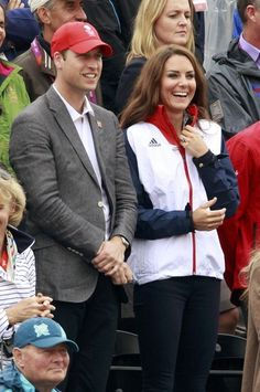 Britain's Prince William and his wife Catherine (R), Duchess of Cambridge, watch the eventing individual jumping final equestrian event at the London 2012 Olympic Games in Greenwich Park July 31, 2012.