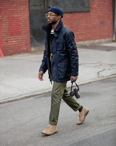 Photographer @xxjmitch on the way to work wearing 770 Straight-fit chinos in catskill green. #jcrewalways