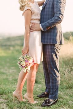 Such a stylish couple - we love that check suit! Beautiful photo by Peter and Veronika Photography