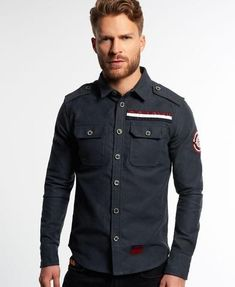 Superdry men's Scout Leader Moleskin shirt. This long sleeved shirt with soft touch finish features a tricolour SD Army patch on the chest, buttoned shoulder epaulettes, two buttoned chest pockets and buttoned cuffs. Made with quality fabric, the ...