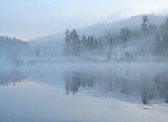 Morning fog lifting at Pinetorch Lake, Temagami wilderness.