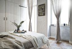 Quarto em estilo rústico e industrial, no apartamento de Marcel Graf