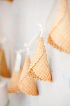 String up waffle cones to make an adorable garland for an ice cream party.