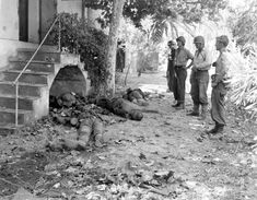 USA and WW2.  US soldiers look at deceased German soldiers near Toulon, France on 16 August 1944