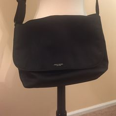 Kate Spade messenger bag Black nylon with Velcro enclosure-outside pocket- 14X9- small smudge (see pic)-great condition-only used a few times kate spade Bags Shoulder Bags