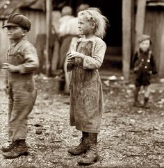 """""""At the Maggioni Canning Company in Port Royal, South Carolina, children shucked oysters for 4 hours before a half day of school, returning for 3 more hours of work after school""""  Lewis Hine"""