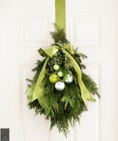 Green Christmas Door Hanging - Bundled together with floral wire, fragrant greenery — yew, holly, spruce, and eucalyptus Noel Christmas, Green Christmas, Christmas Projects, Winter Christmas, Holiday Crafts, Christmas Wreaths, Christmas Greenery, Xmas, Classy Christmas