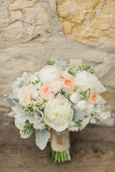 Rustic white and peach bouquet: http://www.stylemepretty.com/2014/11/21/rustic-elegance-at-holman-ranch/   Photography: Carlie Statsky - http://www.carliestatsky.com/