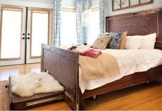 Bed made of old doors with a pet pullout bed at the end