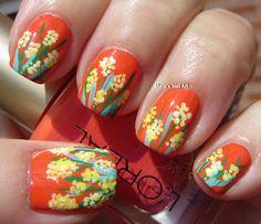 Small pastel yellow flowers on hot orange