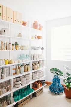 Studio Tour: Shotgun Floral Studio -- THAT TURQUOISE CHANDELIER THERE ON THE FLOOR