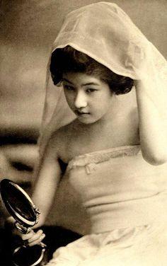Geisha with mirror and veil