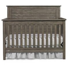 The Fisher-Price® Quinn Convertible Crib is an updated and refined take on the popular lodge look. The stacked panels surrounded by the substantial molding make this full panel crib a beautiful addition to the nursery. This crib transitions easily with each stage of growth; from crib to toddler and day bed, and finally, a full-size headboard. Optional guardrail for toddler bed and metal bed frame available and sold separately. Available in Vintage Grey, Wire Brushed White, Wire Brush...