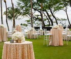 What better way to celebrate than dining al fresco along the seaside in Hawaii? For this spectacular dinner celebration, the Colin Cowie Celebrations team drew inspiration from the beautiful island locale. Textured white tablecloths were lined with vases overflowing with deep coral colored flowers,
