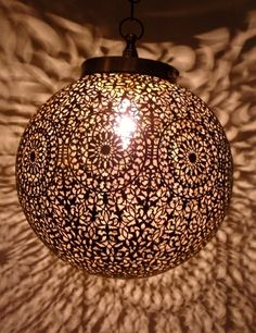 Moroccan brass ceiling lamp, pendant light round shape with its outstanding chiselled openwork patterns. Moroccan Lighting, Moroccan Art, Moroccan Lanterns, Moroccan Interiors, Moroccan Design, Lantern Pendant Lighting, Pendant Lamp, Diy Luminaire, Round Pendant Light