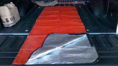 Use velcro to turn a regular tarp into an emergency sleeping bag. Cheap and folds up small  light for the truck's emergency duffel bag.