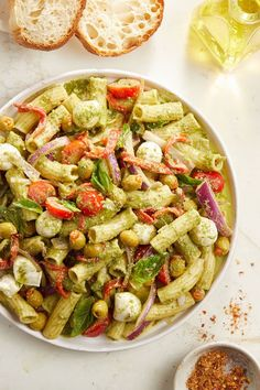 Start a new tradition and celebrate the bold, bright and briny flavors of the Mediterranean in this colorful cold pasta salad. This all-star recipe features briny olives, smoky roasted red pepper, creamy bites of fresh mozzarella and twisted tube pasta in a herbaceous basil pesto dressing.