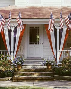 Festive Porch Display ~ This porch displays red, white & blue bunting (the fabric that flags are made from) that has been tacked to the eaves and tied with ribbon at the bottom. The trios of small flags are held up by aluminum brackets. Fourth Of July Decor, 4th Of July Celebration, 4th Of July Decorations, 4th Of July Party, July 4th, Memorial Day Decorations, Diy 4th Of July Bunting, Patriotic Bunting, Patriotic Wreath
