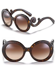 Thick round frames and curling temples make for statement-making sunglasses from Prada. | Made in Italy | 100% UV protection | Havana frames with brown gradient lenses; Black frames with black or smok