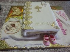 Bible themed christening cake with fondant bootees and fondant baby, chocolate hands and fondant blanket