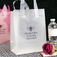 8 x 10 Frosted poly out of town guest gift bags personalized with a wedding design and up to 4 lines of print are semi-transparent. Add colored tissue paper to create a unique look and make the bride and groom's name and wedding date pop! Fill the bags with local favorite snacks and goodies, bottled water, a travel sewing kit, local attractions map and other comfort items to make your out of town guests' stay unforgettable.