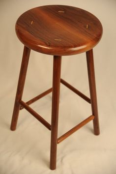 Walnut stool. Straightforward design, but impeccable craftsmanship. Via http://lumberjocks.com/projects/70994