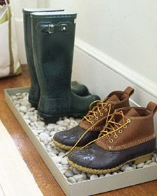 tray + rocks = cool place to put dirty, muddy, wet shoes when you get in the house! (via Martha Stewart)