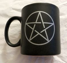 Up for sale is the ceramic mug pictured. Features a Pentacle on both sides of the black mug. The 12oz mug is both Dishwasher and Microwave safe! I have more Pagan goodies available in my store as well