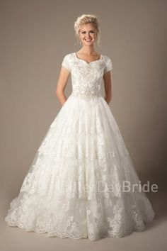 lds wedding dresses | Cecily | Modest bridal | LatterDayBride | This stunning bridal gown features a lovely sweetheart neckline and a dazzling beaded bodice complimented by a full skirt with tiered lace.   Gown available in White/Silver, Ivory/Silver or Champagne/Ivory/Silver *Gown pictured in Ivory/Silver Sleeve length or neckline can be customized.