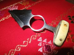 push dagger recycled steel, bone handle. from LASO.