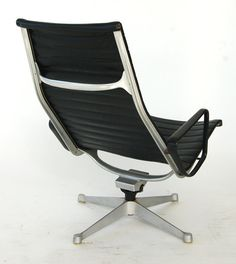 """Design Charles and Ray #Eames  Polished and Rubber Coated Aluminum, Naugahyde Sling  Vintage Original, 1960's  Manufactured by Herman Miller®  25"""" (64cm) w 