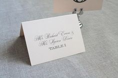 Coordinate your wedding reception tables with blush pink place cards. Listed here you blush pink place cards that are part of a full invitation, menu, place card and table number set. Each place card is printed onto a lovely matte, blush pink card stock with black text. The card stock has a luxe texture to it and measures 2.5x3.5 when folded.  Use as place cards, escort cards ... add in menu selections - anything you need! *Blush pink is not one of my signature colors, which means I dont…