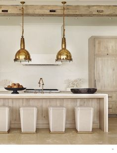 Antique light fixtures, a Venetian plaster hood and Lee Industries stools lend the sleek kitchen a calming effect. Kitchen Interior, Kitchen Design, Kitchen Decor, Basement Kitchen, Kitchen Layout, Kitchen Colors, Rustic Kitchen, Country Kitchen, Home Staging
