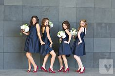 Love the reddish pink shoes with the navy blue bridesmaid dresses