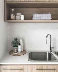 Who knew doing laundry could be so beautiful. We are crushing on this laundry by… Who knew doing laundry could be so beautiful. We are crushing on this laundry by featuring our laundry stainless sink and… Laundry Tubs, Laundry In Bathroom, Basement Bathroom, Laundry Cupboard, Modern Laundry Rooms, Laundry Storage, Small Laundry, Bathroom Ideas, Laundry Decor