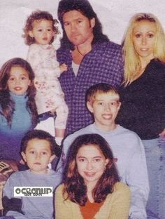 Miley cyrus and her family (brothers, sisters, and parents)