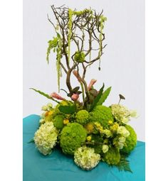 Manzanita branch, hydrangea, ranunculus, ginger, kermit mums, amaranthus, roses, lotus pods, bird's nest fern, leather leaf fern, protea, and hanging jewels