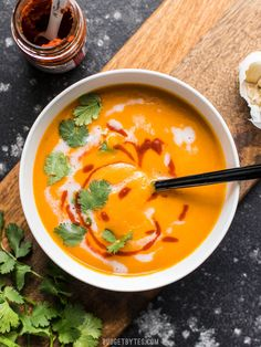 You only need a few ingredients to make this light and satisfying Thai Coconut Curry Carrot Soup. It's a creamy, a little sweet, a little spicy, and a lot of delicious. BudgetBytes.com