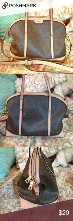 DKNY Brown and Cream Trim Purse This purse is very cute and spacious. There is a small pen mark on the lower back. It is in good condition and is perfect for every day use! Price is negotiable ;) DKNY Bags Shoulder Bags