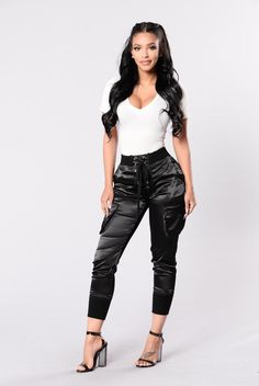 - Available in Blush, Black & White - Satin Jogger Pants - Side Pockets - Tie Up Front - Elastic Waist Band - Elastic Band Ankle - 100% Polyester 95% Cotton 5% Spandex