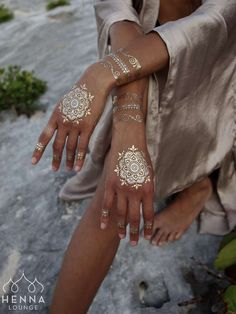 """Gold henna temporary tattoo! www.HennaLounge.com """"Sundara"""" collection now available at www.NudInk.com #goldhenna #whitehenna #nudink #flashtats #flashtattoos #indian #hennadesigns"""